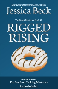 dark blue book cover, with a donut with white striped icing