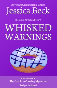 purple book cover, with a donut with blue icing and decorative lines