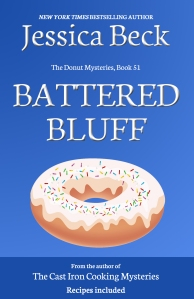 blue book cover, with a donut with white icing